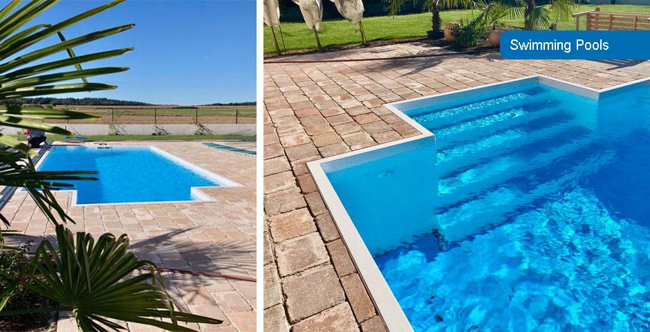 Swimming Pool mit mediterranem Pflaster umrandet